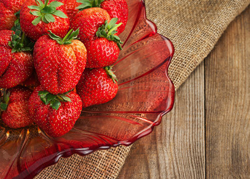 A bowl of ripe strawberries, ideal for baby food recipe